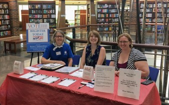 Kiersten and Talor registering people to vote at the Coralville Public Library with the help of Julie from The Johnson County League of Women Voters.